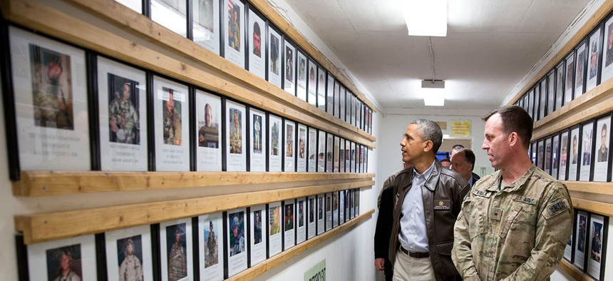 President Barack Obama and Brig. Gen. Erik Kurilla view photos of fallen military personnel at Bagram Airfield, Afghanistan, Sunday, May 25, 2014.