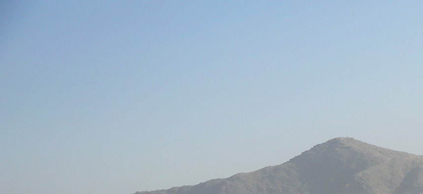 A Black Hawk flies over the city, during Britain's Prime Minister David Cameron visit, in Kabul, Afghanistan, Oct. 3, 2014.