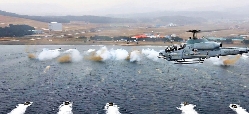 Troops from the Republic of Korea Marines and the 7th Marine Regiment participate in a mock amphibious landing during exercise Ssang Yong, on March 29, 2014.