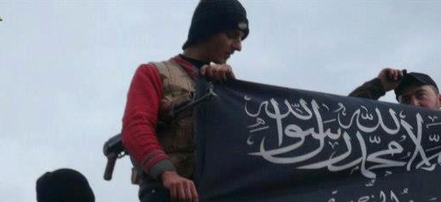 Al-Qaeda affiliated Jabhat al-Nusra insurgents wave their flags in Idlib province, northern Syria.