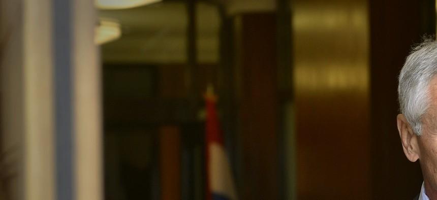 Defense Secretary Chuck Hagel waits for the arrival of Minister of Defense of the Netherlands Jeanine Hennis-Plasschaert, on October 7, 2014.