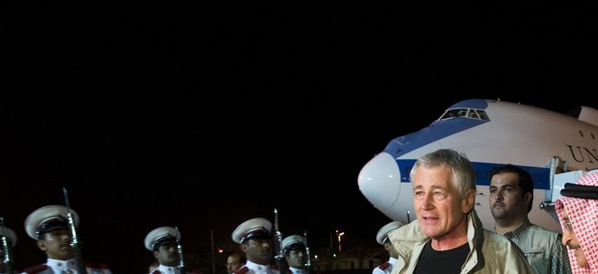 Defense Secretary Chuck Hagel is escorted through an honors ceremony by Bahraini Lt. Gen. Sheikh Mohammed Al Khalifa, in Bahrain, in advance of the 2013 Manama Dialogue.