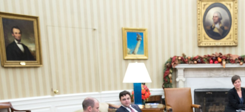 President Obama speaks on the phone with Cuban president Raul Castro, on December 17, 2014.