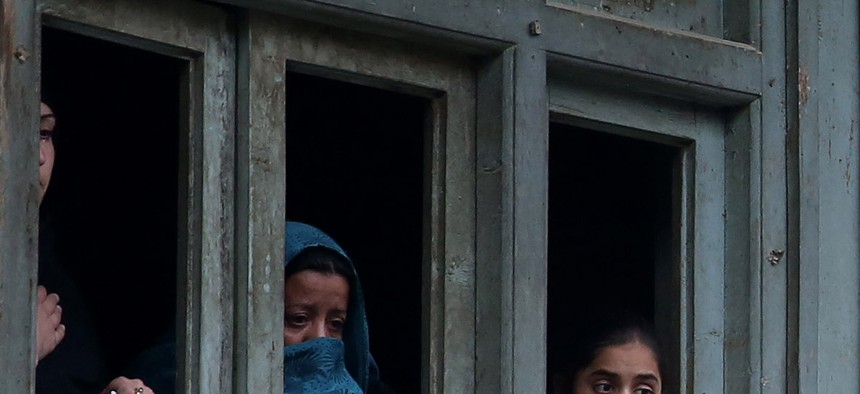 Afghan Shiite women watch a religious ceremony ahead of the Ashouraa holiday, on November 2, 2014.