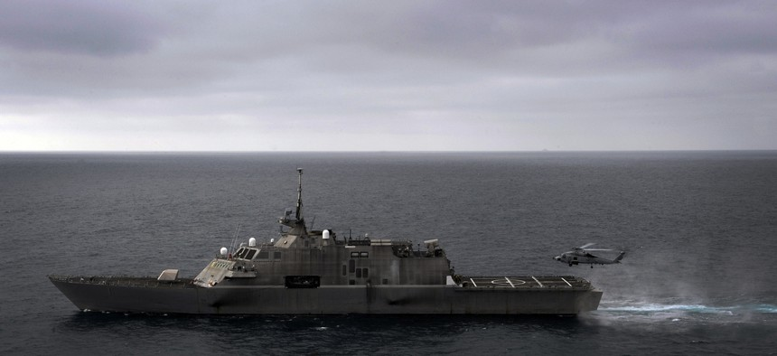 An MH-60R Sea Hawk helicopter assigned to Helicopter Maritime Strike Squadron (HSM) 77 prepares to land aboard the littoral combat ship USS Freedom, on June 7, 2011.