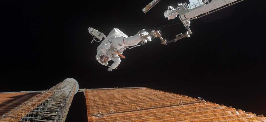 A NASA astronaut goes on a spacewalk to repair a damaged solar panel on the ISS.