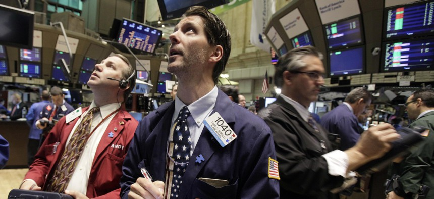 In this May 7, 2010, file photo traders work on the floor of the New York Stock Exchange in New York, following a flash crash.
