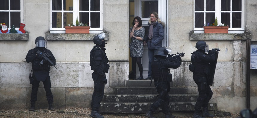 In this Jan.8, 2015 file photo, French police officers patrol in Longpont, north of Paris, France, Thursday, Jan. 8, 2015 in the search for the two suspects in the Charlie Hebdo killing.