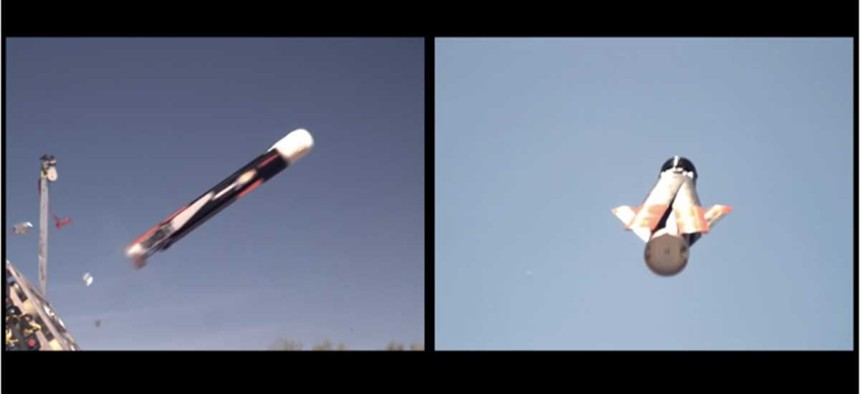 A LOCUST drone is launched out of a tube, during a test by the Office of Naval Research.