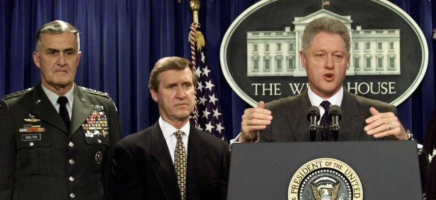 """President Clinton announces that Iraq has """"backed down"""" and has agreed to unconditional inspections by UN weapons inspectors during an appearance in the White House briefing room Sunday Nov. 15, 1998."""