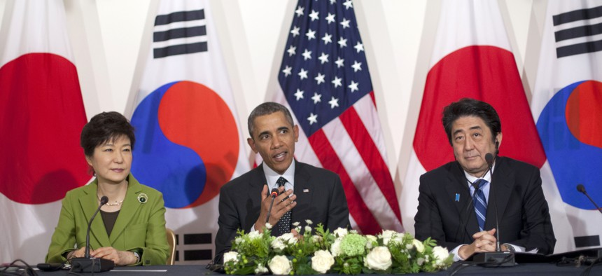 President Barack Obama meets with Japanese Prime Minister Shinzo Abe, right, and South Korean President Park Geun-hye, Tuesday, March 25, 2014.