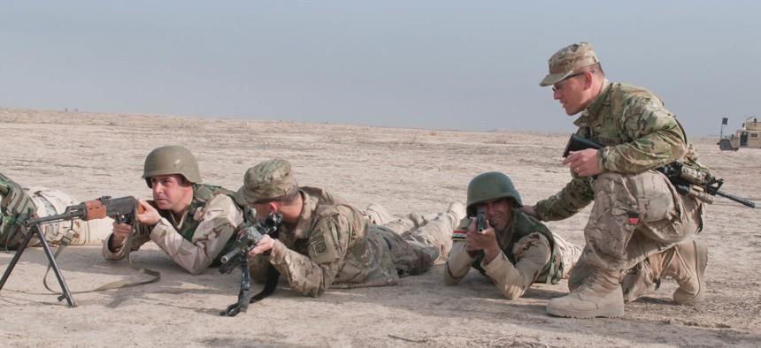 U.S. soldiers instruct Iraqi security forces on defensive tactics at Besmaya Range Complex, Iraq, on March 26.