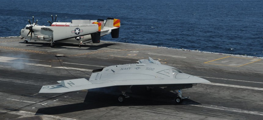 An U.S. Navy X-47B Unmanned Combat Air System demonstrator aircraft makes an arrested landing on the flight deck of the aircraft carrier USS George H.W. Bush (CVN 77) July 10, 2013.