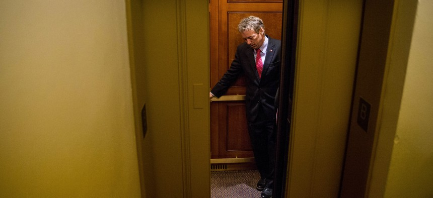 Republican presidential candidate, Sen. Rand Paul, R-Ky. departs in an elevator after speaking at a news conference on Capitol Hill in Washington, Tuesday, June 2, 2015.