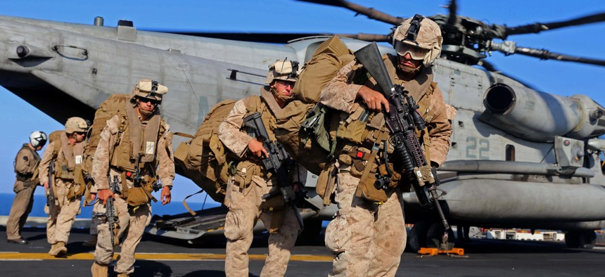Marines with the 11th Marine Expeditionary Unit (MEU), off-load from a CH-53E Super Stallion on Dec. 12, 2014.