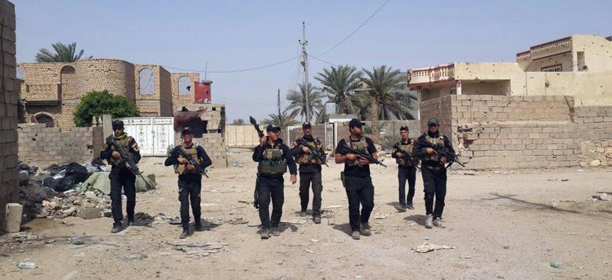 Iraqi anti-terrorism forces patrol in Ramadi, Iraq, Saturday, April 18, 2015.