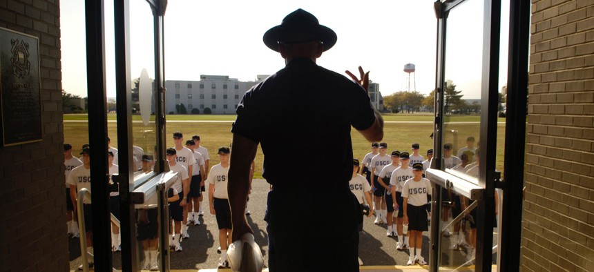 A U.S. Coast Guard company commander instructs new recruits to stand up straight outside of Sexton Hall at Coast Guard Training Center Cape May, NJ, Sept. 22, 2005.