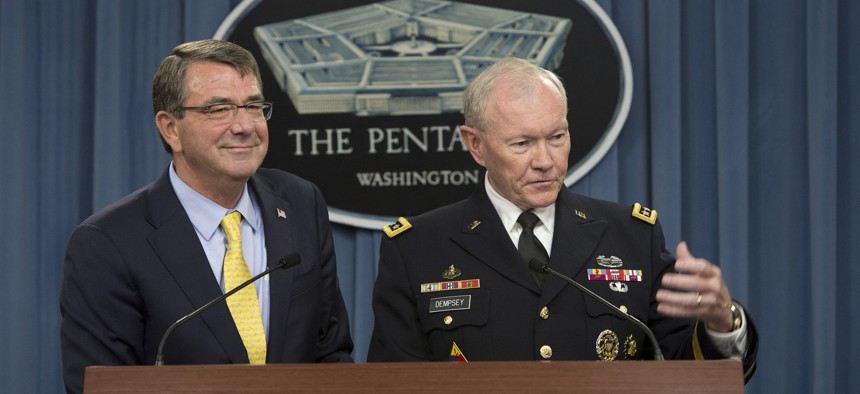 Secretary of Defense Ash Carter and Army Gen. Martin E. Dempsey, chairman of the Joint Chiefs of Staff, brief reporters during a news conference at the Pentagon July 1, 2015.