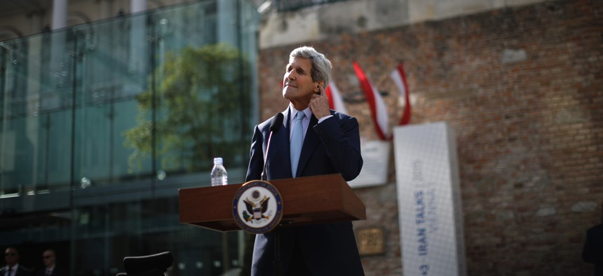 U.S. Secretary of State John Kerry pauses as he listen a question from a journalist after delivering a statement on the Iran talks in Vienna.