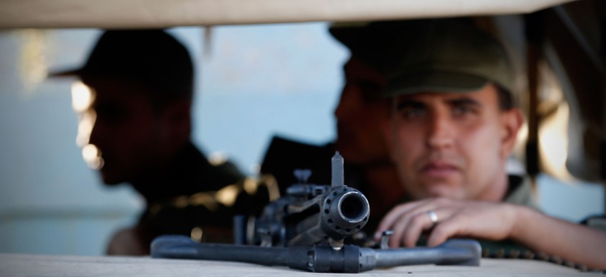 Tunisian army soldiers guard the street near the attacked Imperial Marhaba hotel in Sousse, Tunisia, June 27, 2015.