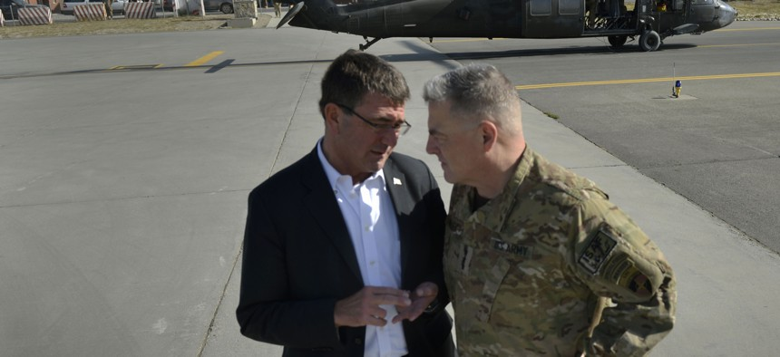 Then-Deputy Defense Secretary Ashton Carter talks with then-Lt. Gen. Mark Milley in Kabul, Afghanistan, on Sept. 16, 2013.