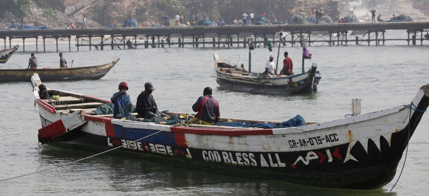Fishermen arrive at the fishing beach in James Town, Accra, Ghana, Thursday, July 9, 2015.