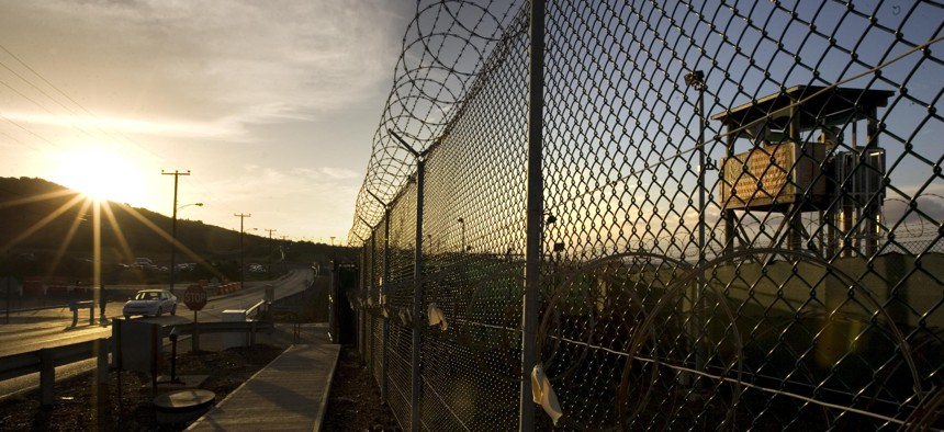 In this photo reviewed by the U.S. Military, the sun rises over Camp Delta detention compound at Guantanamo Bay U.S. Naval Base, in Cuba.