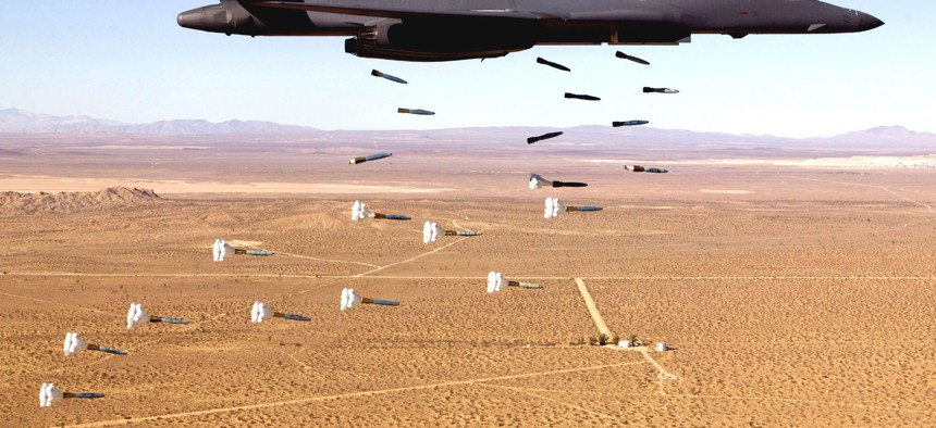 A B-1 Lancer — one of the bombers to be replaced by the Long Range Strike Bomber — drops a load of inert munitions in this file photo.