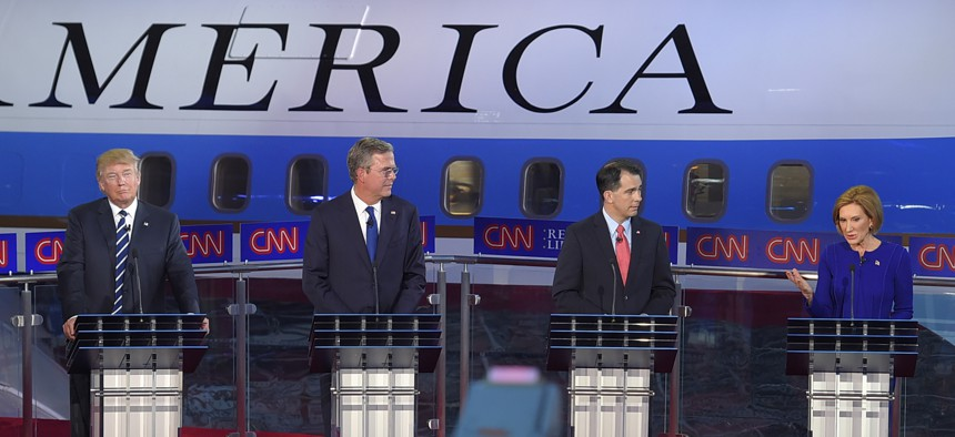 Carly Fiorina, right, with Donald Trump, Jeb Bush, and Scott Walker, talked tough on U.S. military force abroad at the CNN Republican presidential debate, Sept. 16, 2015, in Simi Valley, Calif.