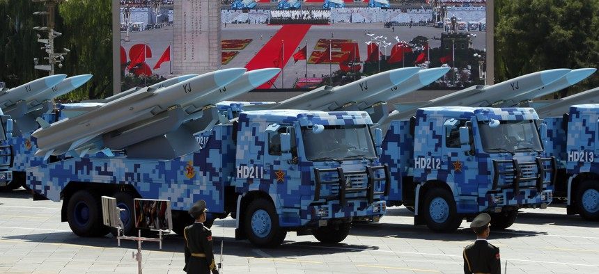 Military vehicles carry YJ anti-ship cruise missiles during a parade with more than 500 pieces of military hardware and 200 aircraft of various types, representing what military officials say is the Chinese military's most cutting-edge technology.