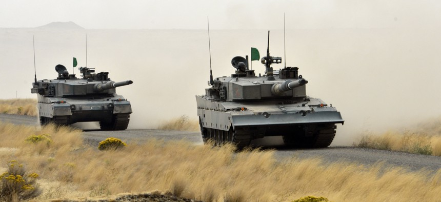 Japanese tankers from the 3rd Combat Team of the Japan Ground Self-Defense Force assault enemy positions during a live fire training exercise Sept. 22, 2012 at the Yakima Training Center.