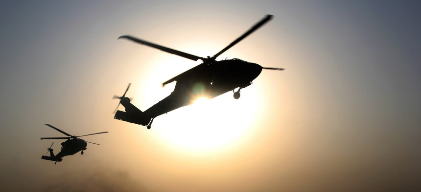 U.S. Army Soldiers, assigned to 101st Combat Aviation Brigade, 101st Airborne Division, hover over a landing zone in UH-60 Black Hawk helicopters during air assault training at Jalalabad Airfield in eastern Afghanistan, Sept. 16, 2015.