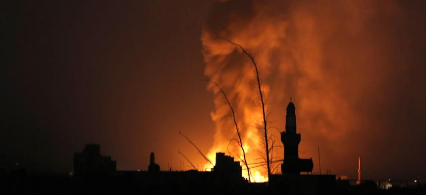 Fire from a Saudi-led airstrike illuminates the night over Sanaa, Yemen, Thursday, Sept. 17, 2015.