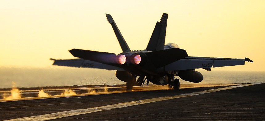 A U.S. Navy F/A-18F Super Hornet launches from the aircraft carrier USS Theodore Roosevelt in the 5th Fleet, Oct. 10, 2015. The aircraft is assigned to Strike Fighter Squadron 11.