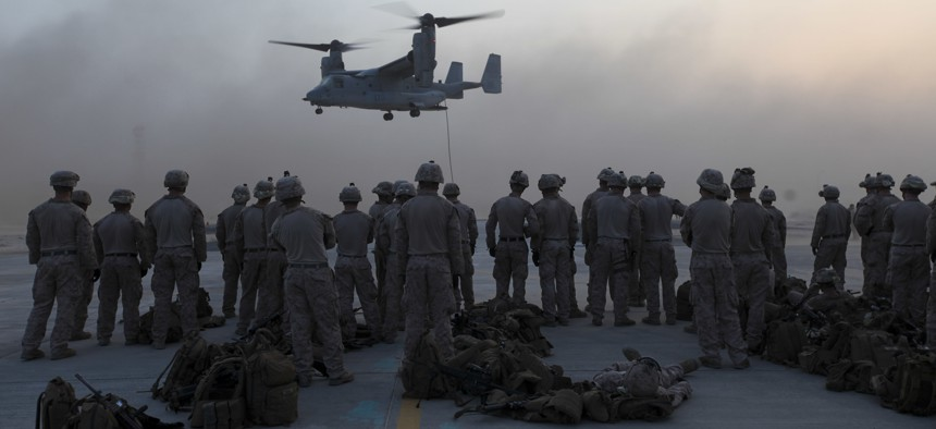 U.S. Marines with the Special Purpose Marine Air Ground Task Force—Crisis Response—Central Command, observe MV-22 Osprey fast rope training in Southwest Asia, Sept. 16, 2015.