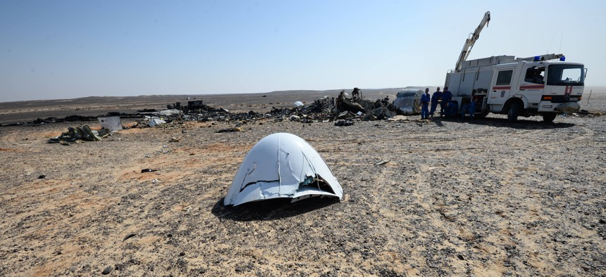 In this Russian Emergency Situations Ministry photo, made available on Monday, Nov. 2, 2015, Russian Emergency Ministry experts work at the crash site of a Russian passenger plane bound for St. Petersburg.