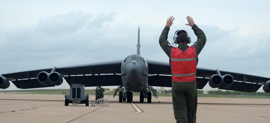 A U.S. Air Force airman marshals a B-52H Stratofortress bomber.
