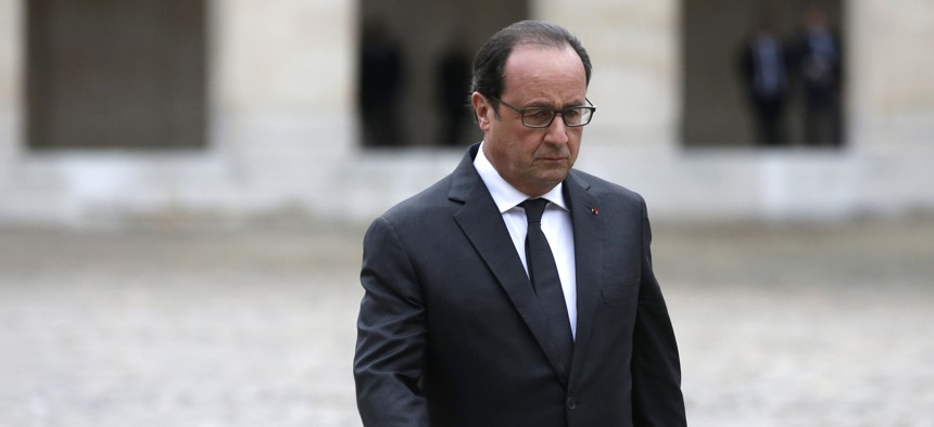 French President Francois Hollande attends a military ceremony at the Hotel National des Invalides, in Paris, Thursday, Nov. 19, 2015.