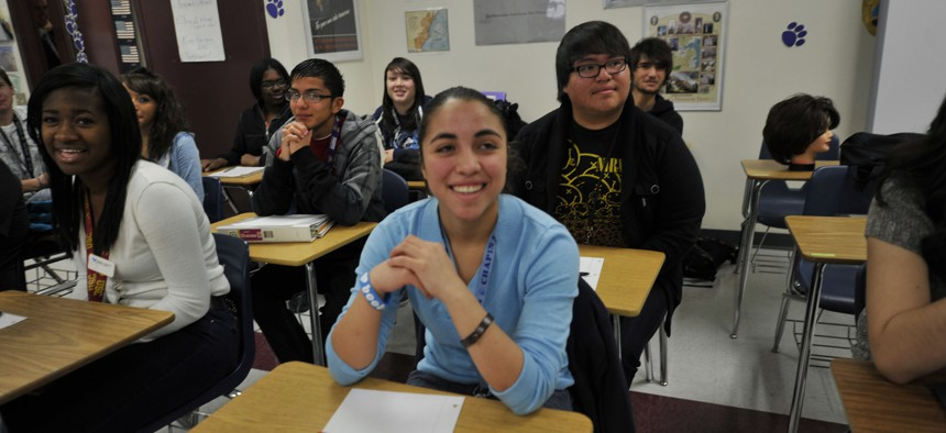 Students listen to Secretary of Defense Leon Panetta teach their national security class, in El Paso, Texas, Friday, Jan. 13, 2012.