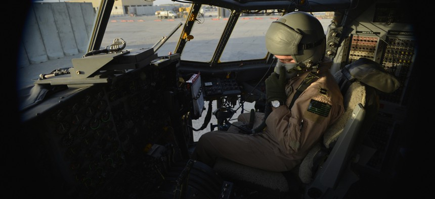 U.S. Air Force Capt. Frank Von Heiland, 41st Expeditionary Electronic Combat Squadron co-pilot, checks his oxygen mask on an EC-130H Compass Call aircraft at Bagram Air Field, Afghanistan, Sept. 12, 2014.