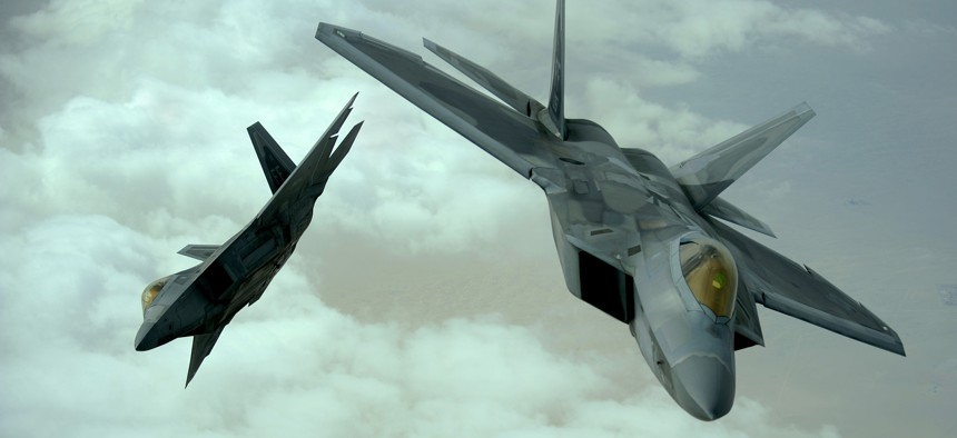 U.S. Air Force F-22 Raptors fly in formation during a training mission, Dec. 6, 2009.
