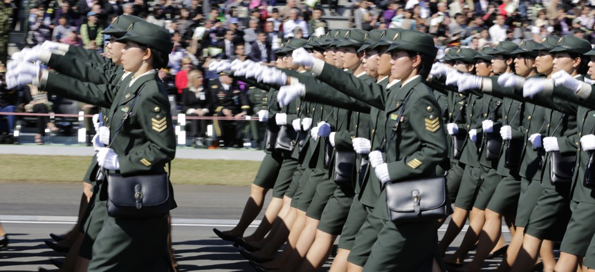 Members of Japan Self-Defense Forces march during the Self-Defense Forces Day at Asaka Base, north of Tokyo, Sunday, Oct. 27, 2013.