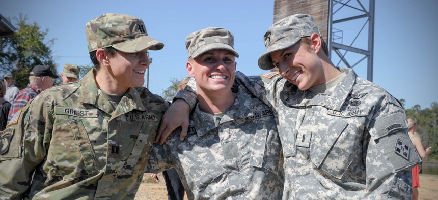 From left, U.S. Army Capt. Kristen Griest, Maj. Lisa Jaster and 1st Lt. Shaye Haver share a moment following Jaster's graduation from Ranger School on Fort Benning, Ga., Oct. 16, 2015.