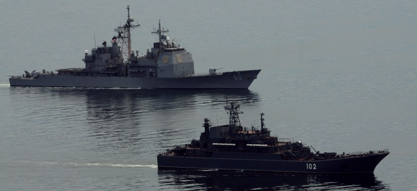 Happier times: The guided-missile cruiser USS Normandy (CG 60), left, and the Russian amphibious ship RFS Kaliningrad (LSTM 102) conduct anti-piracy training during the Baltic Operations (BALTOPS) 2012 exercise.