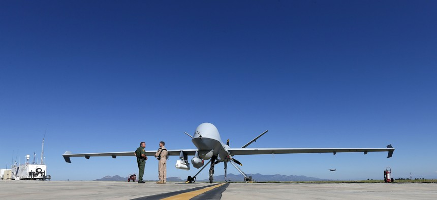 Lothar Eckardt, right, executive director of National Air Security Operations at U.S. Customs and Border Protection, speaks with a Customs and Border Patrol agent prior to a drone aircraft flight, Wednesday, Sept 24, 2014.