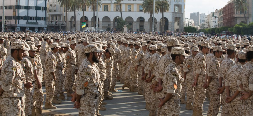Military units which operate under the Tripoli government stand in formation during a celebration of the 75th anniversary of the establishment of the Libyan Army in Martyrs Square, Tripoli, Libya, August 2015.