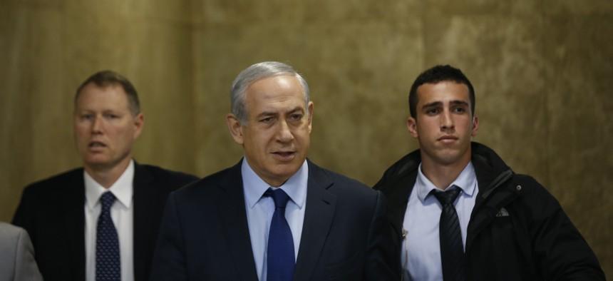 Israel's Prime Minister Benjamin Netanyahu, center, arrives for the weekly cabinet meeting in Jerusalem, Sunday, Dec. 13, 2015.