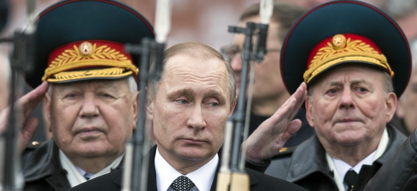 On Defenders of the Fatherland Day, Russian President Vladimir Putin attends a wreath-laying ceremony at the Tomb of the Unknown Soldier in Moscow, Feb. 23, 2016.