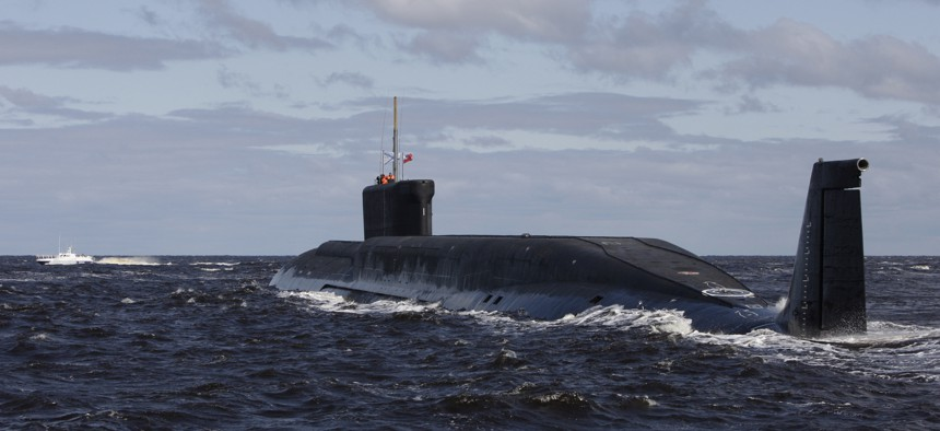 This Thursday July 2, 2009 file photo, shows a new Russian nuclear submarine, Yuri Dolgoruky, near the Sevmash factory in the northern city of Arkhangelsk, Russia.
