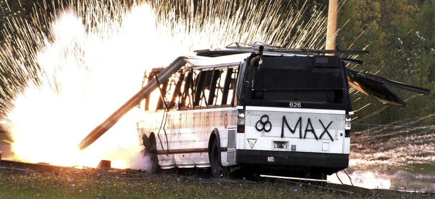 """In this photo made from video a simulated radioactive """"dirty bombs"""" explodes on a bus which was used to test the ability of federal and local agencies to deal with a real terrorist attack Tuesday, Oct 16, 2007, in Portland, Ore."""